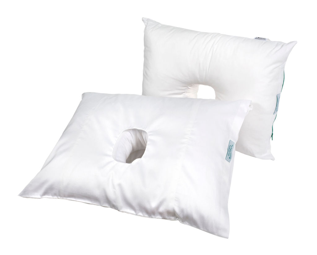 Two pillows with a hole displayed next to each other