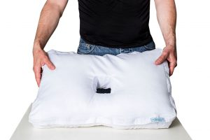 Fitting the pillowcase on the original pillow with a hole