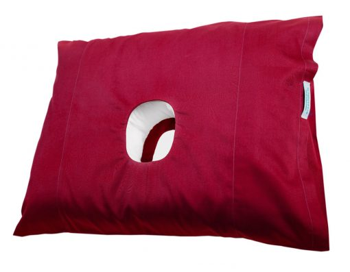 The original pillow with a hole in with a cherry coloured pillowcase